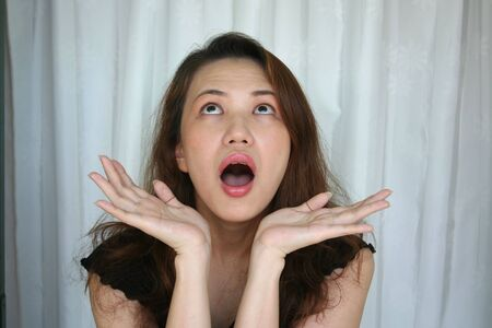 woman surprised face experession photo