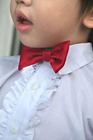 page boy with red bow-tie