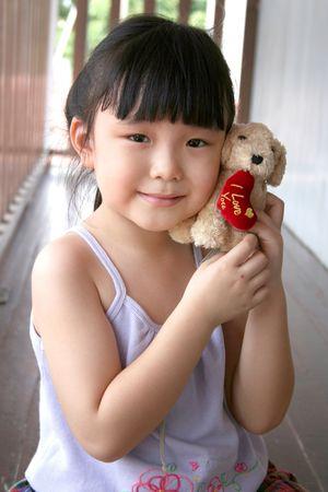 andamp: girl smiling andamp,amp, holding toy dog