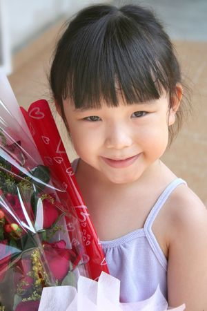 andamp: girl smiling andamp,amp, holding bouquet of red roses