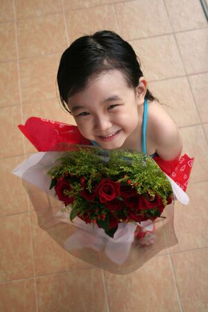 andamp: girl standing, smiling andamp,amp, holding bouquet of red roses