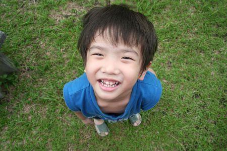 singlet: little boy in blue singlet looking up