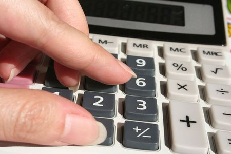 budgets: womans hand calculating on calculator
