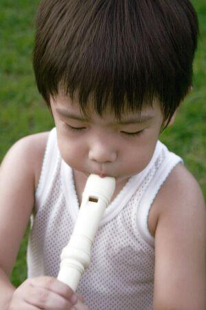 singlet: little boy in singlet playing flute