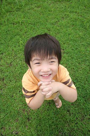 both: Boy crossing both hands looking up
