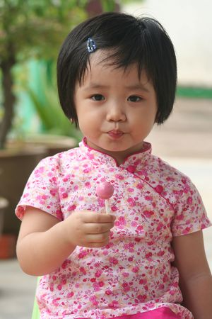 Girl holding a pink lolly pop Stock Photo - 574171