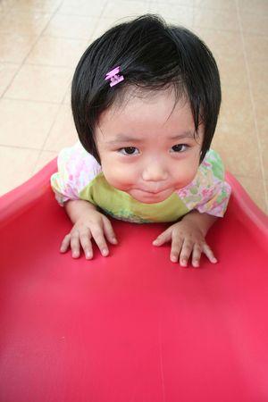 Little girl on the slide photo
