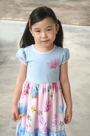 pony tail: Little girl with pony tail standing alone