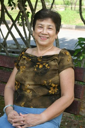 asian hair: Old woman sitting on the bench in the park