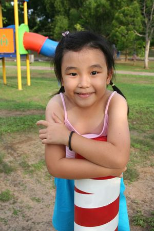 singlet: Happy girl wearing pink singlet at the playground