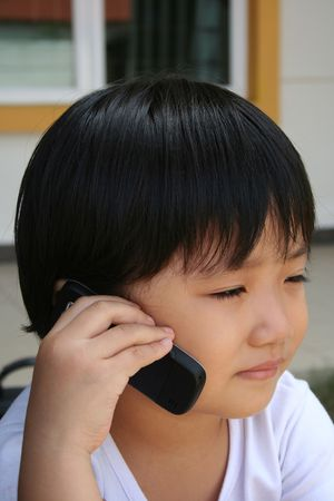 telecommute: Cute little girl talking on the mobile phone