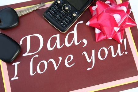 mobilephones: Brown greeting card for father with mobile phone, car key and ribbon