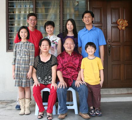 happy asian family: Happy Asian family smiling and taking photo at home