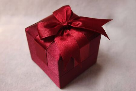Red gift box and red ribbon photo