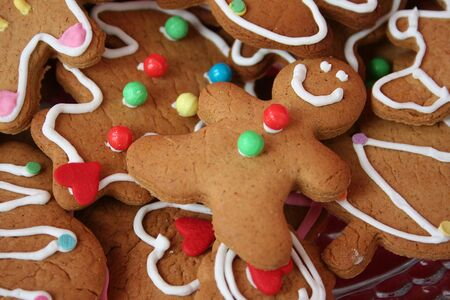 Colorful cute christmas gingerbread man cookies photo