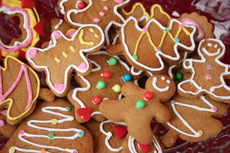Colorful christmas gingerbread man and tree cookies photo