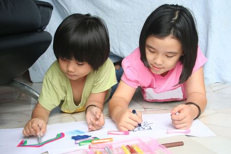 kids drawing: Little girls doing art painting at home together