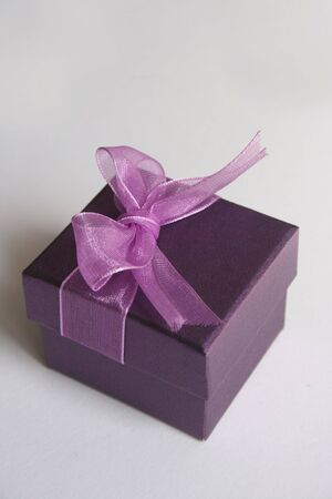 Purple gift box on white background isolated Stock Photo - 6271431