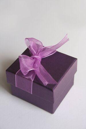 Purple gift box on white background isolated photo