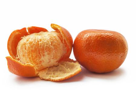High quality original peeled Mandarins Tangerines Closeup isolated on white background