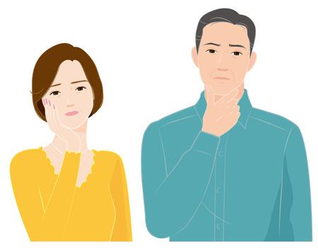 疑問を感じている年配のカップル 写真素材