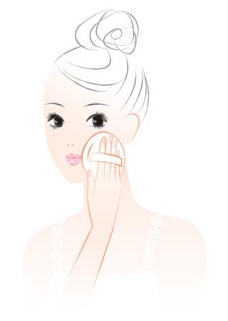 Une femme qui se maquille. Fond de teint poudre poudre.