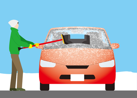 Use a squeegee to remove frost on the windshield of the car