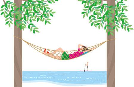 Woman relaxing in a hammock in the resort