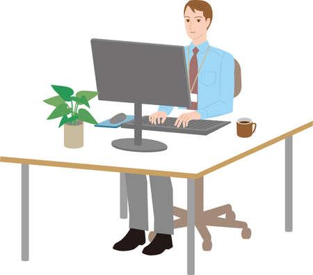 Businessman operating a desktop computer at the desk