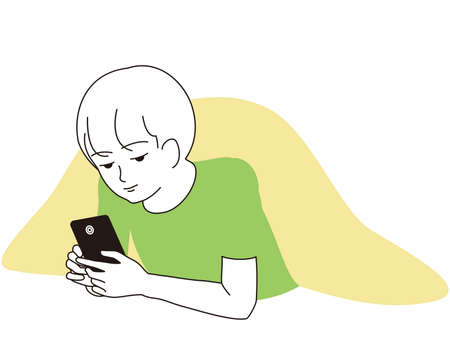 A boy staring at his smartphone lying down
