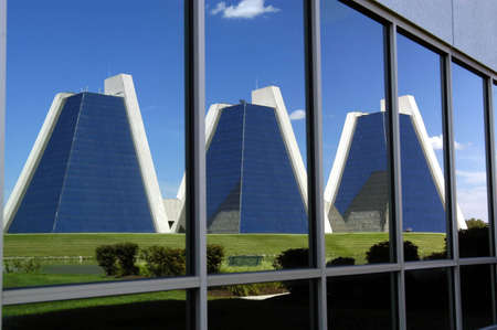 A reflection of pyramid office buildings in Indianapolis Indiana Stock Photo