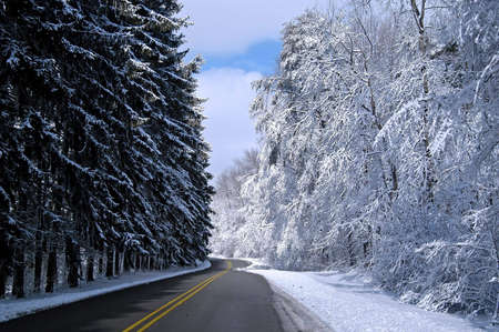 A picture of a snow covered road taken after a storm in Indiana                            Stock Photo