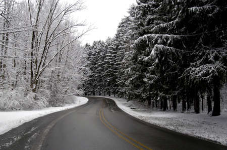 A picture of a snow covered road taken after a storm in Indiana