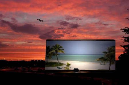 A picture of a billboard showing a beach with a jet taking of in the background Stock Photo
