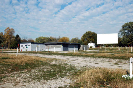 A picture of a vintage closed drive in movie theater
