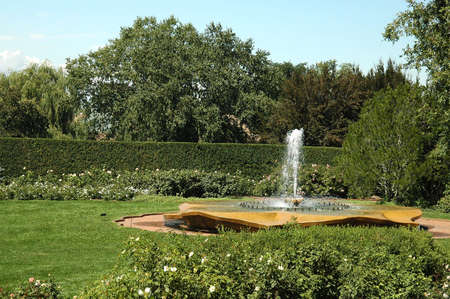 A picture of a English garden with a fountain Stock Photo