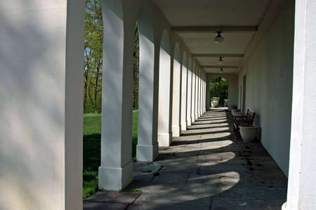 A picture of the back patio of a large mansion