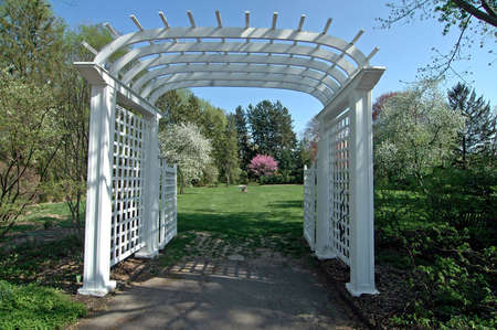 entrance arbor: A picture of a rose arbor in the spring Stock Photo