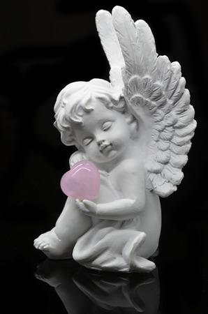 Beautiful white Angel on black background photo