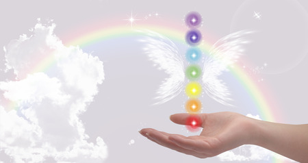 universal enlightenment: Healing hand and seven chakras Stock Photo