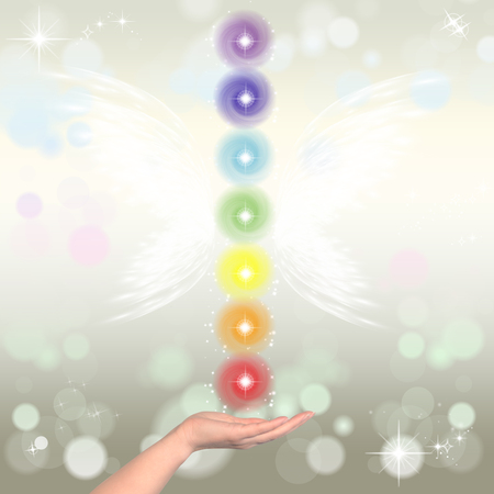 complementary therapies: Healing Hands and seven chakras on a sparklingpastel coloured background Stock Photo