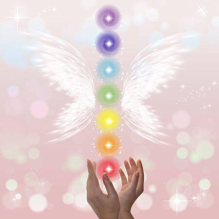 universal love: Healing Hands y siete chakras en un fondo color sparklingpastel