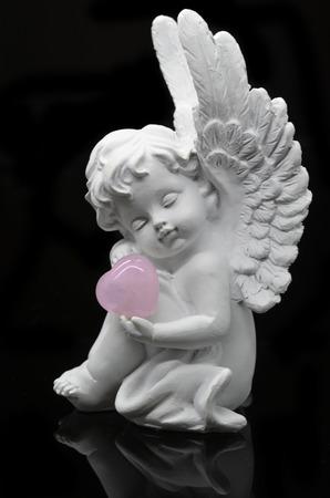 universal healer: Beautiful White Angel isolated on black background Stock Photo