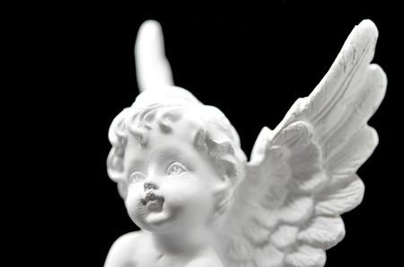 healer: Beautiful White Angel isolated on black background Stock Photo