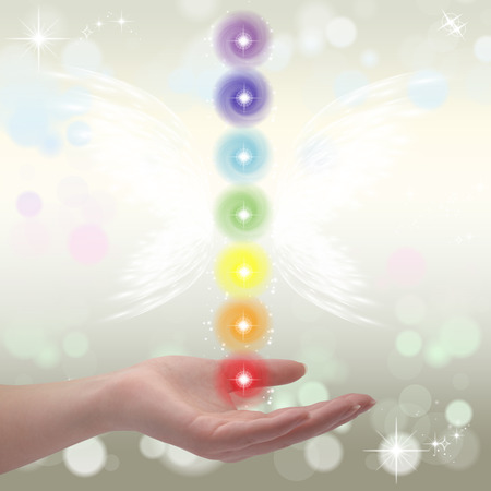 SELF HEALING: Healing Hands and seven chakras on a sparkling pastel coloured background
