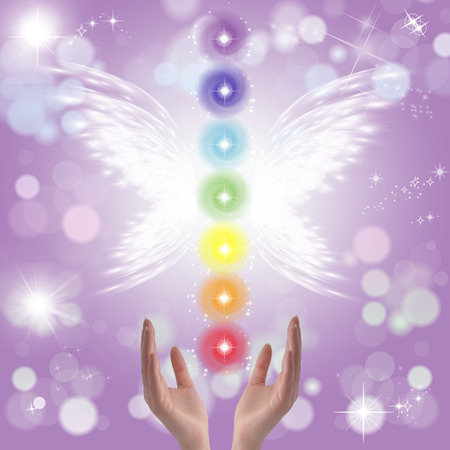 chakra energy: Healing Hands and seven chakras on a sparkling pastel coloured background