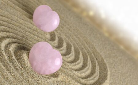 rose quartz: Rose quartz hearts placed in zen garden