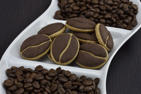 colombian food: Delicious coffee cookies with coffee beans on a corrugated tray Stock Photo