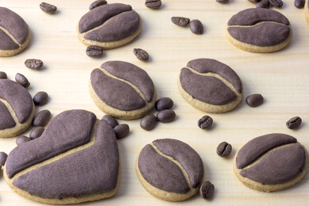 coffeebeans: Delicious coffee cookies arranged on a wooden tray