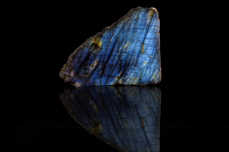 spiritual energy: Sample of a beautiful natural raw Labradorite specimen over black background